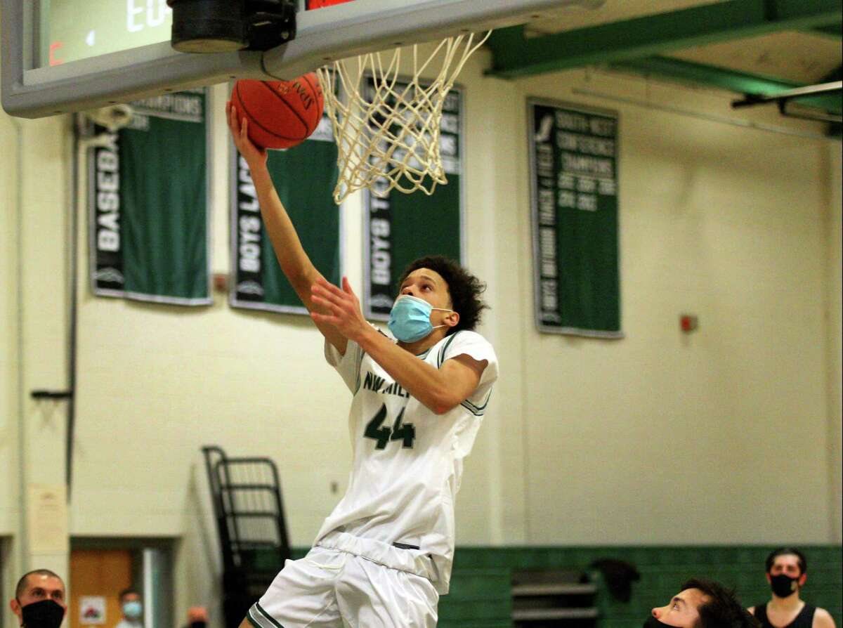 New Milford's JoJo Wallace, son of former Knick John Wallace, hits a layup against Joel Barlow in New Milford on Feb. 13.
