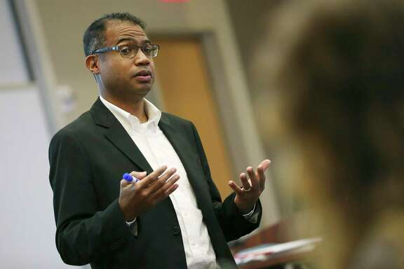 "Trinity University history chair Carey Latimore lectures on African American history on Feb. 6, 2020. He wants to begin a new, ""third way"" of talking about the Alamo and the Texas Revolution, acknowledging slavery as ""part of a larger number of issues"" but not the main reason for the war of independence from Mexico."
