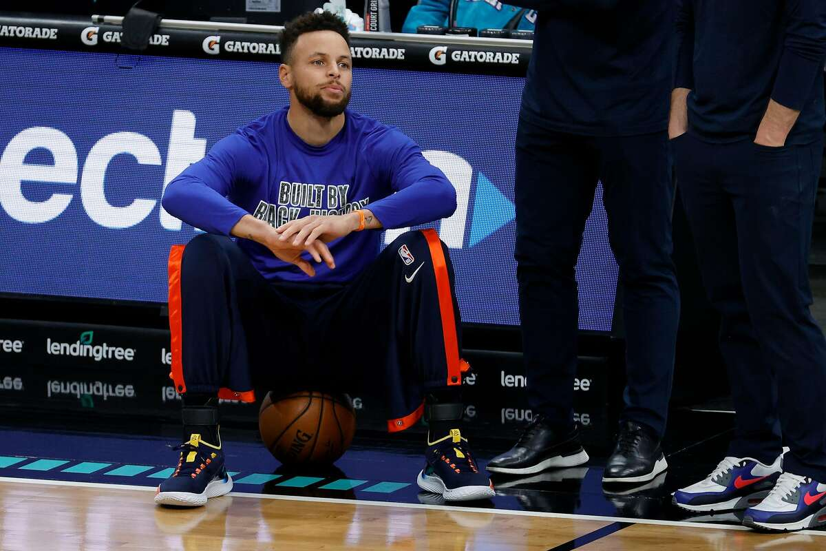 CHARLOTTE, NORTH CAROLINA - FEBRUARY 20: Stephen Curry #30 of the Golden State Warriors looks on prior to their game against the Charlotte Hornets at Spectrum Center on February 20, 2021 in Charlotte, North Carolina. NOTE TO USER: User expressly acknowledges and agrees that, by downloading and or using this photograph, User is consenting to the terms and conditions of the Getty Images License Agreement. (Photo by Jared C. Tilton/Getty Images)