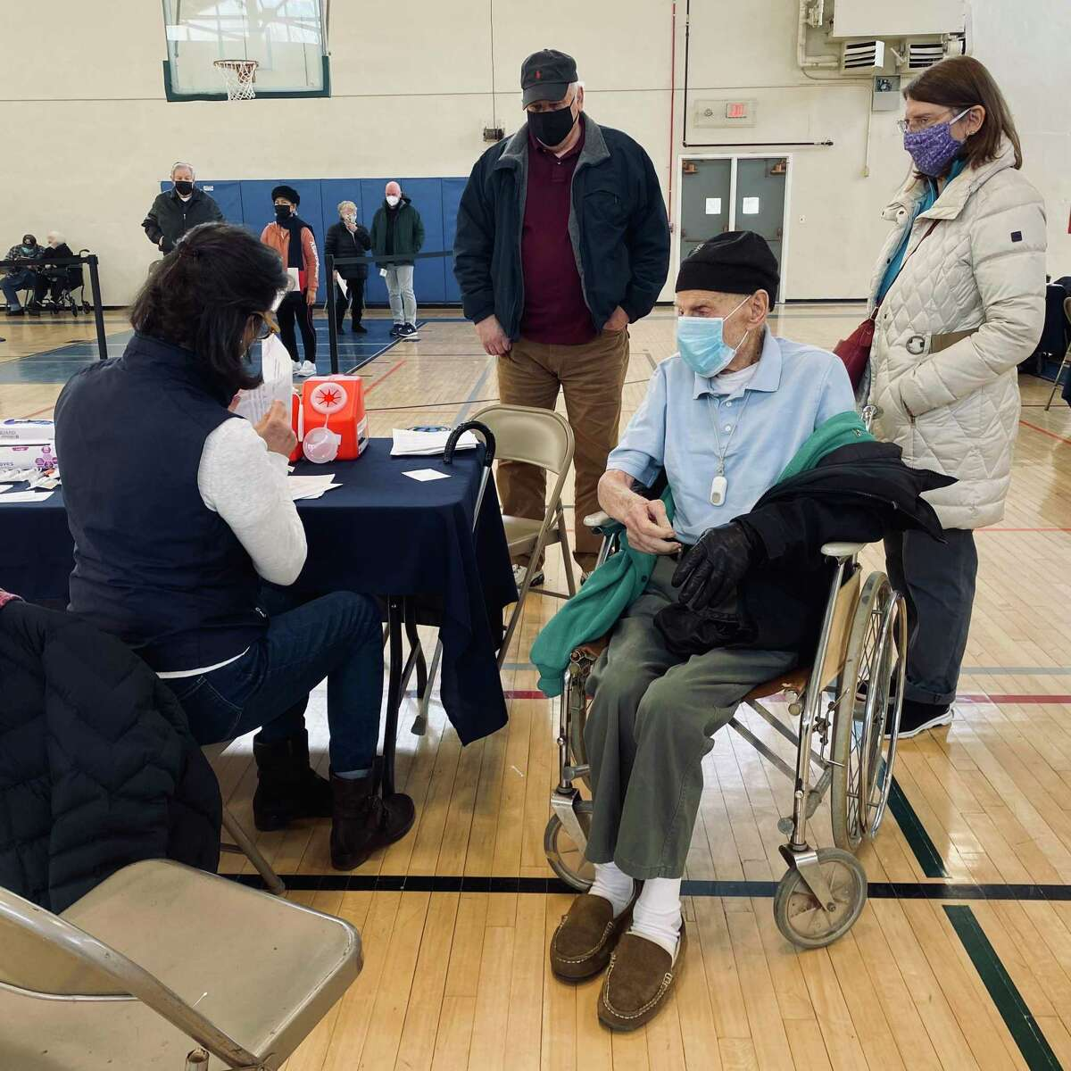 Darien's Alfred Andreoli, who will turn 103 in April, recently received his second dose of the Moderna vaccine in Darien's vaccination clinic. His daughter Patricia and son-in-law James received their first dose.