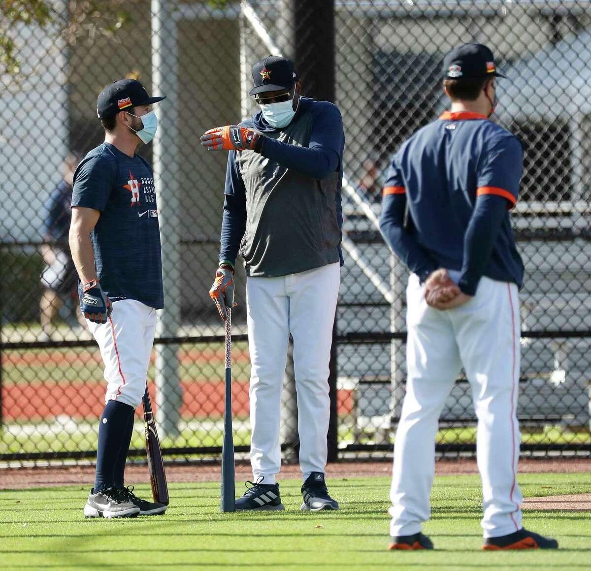 Houston Astros manager Dusty Baker talks with catcher Garrett Stubbs during the first full squad workouts for the Astros, in West Palm Beach, Florida, Monday, February 22, 2021.