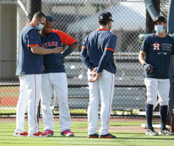Houston Astros hitting coach Alex Cintron and catcher Martin Maldonado check the video of his swing during the first full squad workouts for the Astros, in West Palm Beach, Florida, Monday, February 22, 2021. Photo: Karen Warren, Staff Photographer / @2021 Houston Chronicle