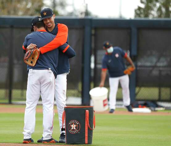 Houston Astros shortstop Carlos Correa gives hitting coach Troy Snitker a hug during the first full squad workouts for the Astros, in West Palm Beach, Florida, Monday, February 22, 2021. Photo: Karen Warren, Staff Photographer / @2021 Houston Chronicle
