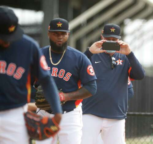 Houston Astros pitching coach Brent Strom takes a video of pitcher Francis Martes throwing during the first full squad workouts for the Astros, in West Palm Beach, Florida, Monday, February 22, 2021. Photo: Karen Warren, Staff Photographer / @2021 Houston Chronicle