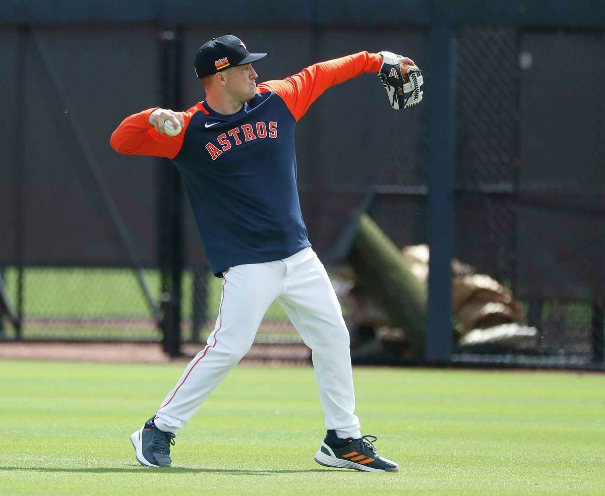 Houston Astros third baseman Alex Bregman warms up during the first full squad workouts for the Astros, in West Palm Beach, Florida, Monday, February 22, 2021.