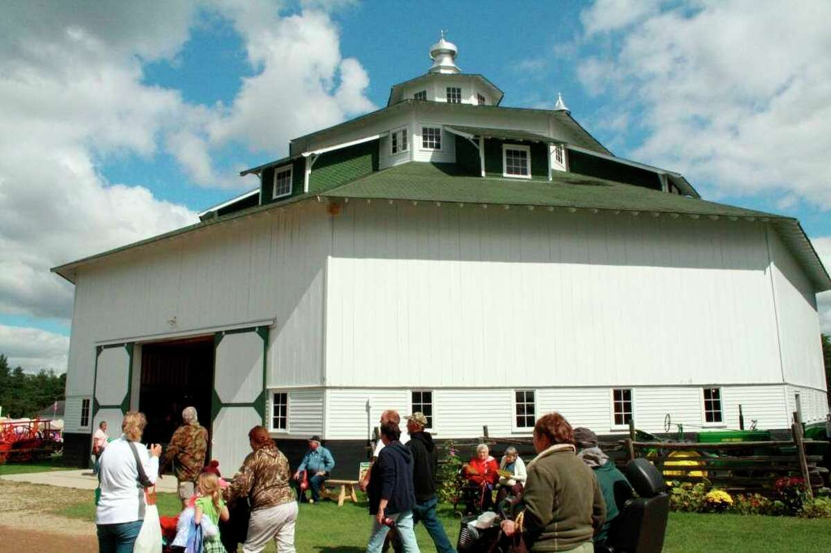 Guests walk by the Thumb Octagon Barn during a past Fall Family Days. The committee that runs the Thumb Octagon Barn Agriculture Museum is still monitoring state COVID regulations for when it can open back up. (Tribune File Photo)