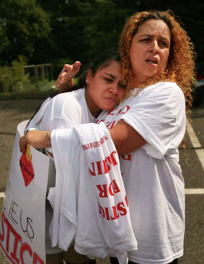 2010 Sacred Heart University graduate Jasmine Vega, left, is comforted by her mother Jacqueline Rossy-Vega, both of Bronx, NY, at a rally for Jasmine's cause outside Sacred Heart University in Fairfield on Tuesday, September 7, 2010. Vega was injured in a sorority hazing incident on October 2, 2009. Photo: Brian A. Pounds / Connecticut Post