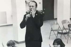 Captain Warren Yoder of the Salvation Army oversees youth participating in the Kid's Korner, a local Salvation Army Citadel. December 1977