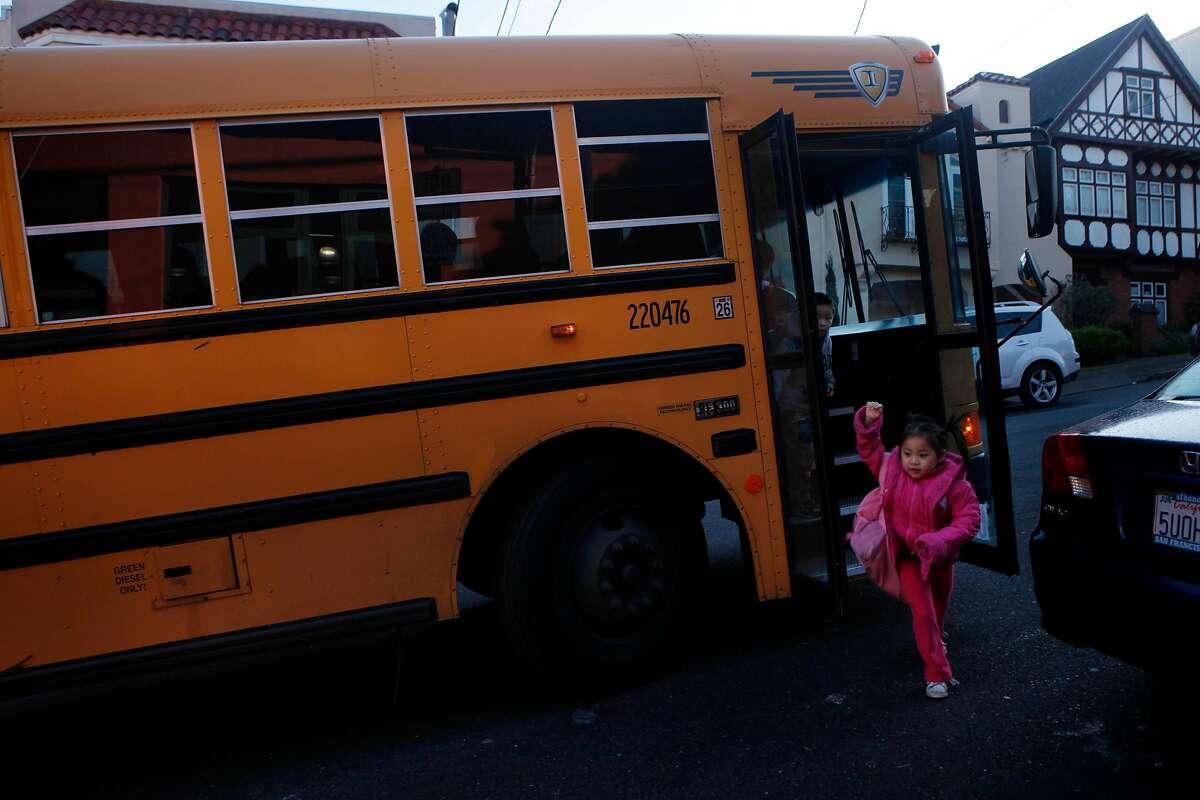 Children disembark arrive for school at Alice Fong Yu K-8 School in San Francisco.