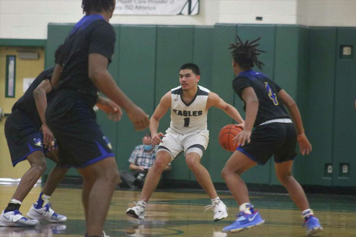 Pasadena point guard Kanye Ortiz is confronted by three Channelview defenders during a district game. The team's leader in more ways than one, Ortiz helps the Eagles celebrate their first playoff berth in 28 years tonight.