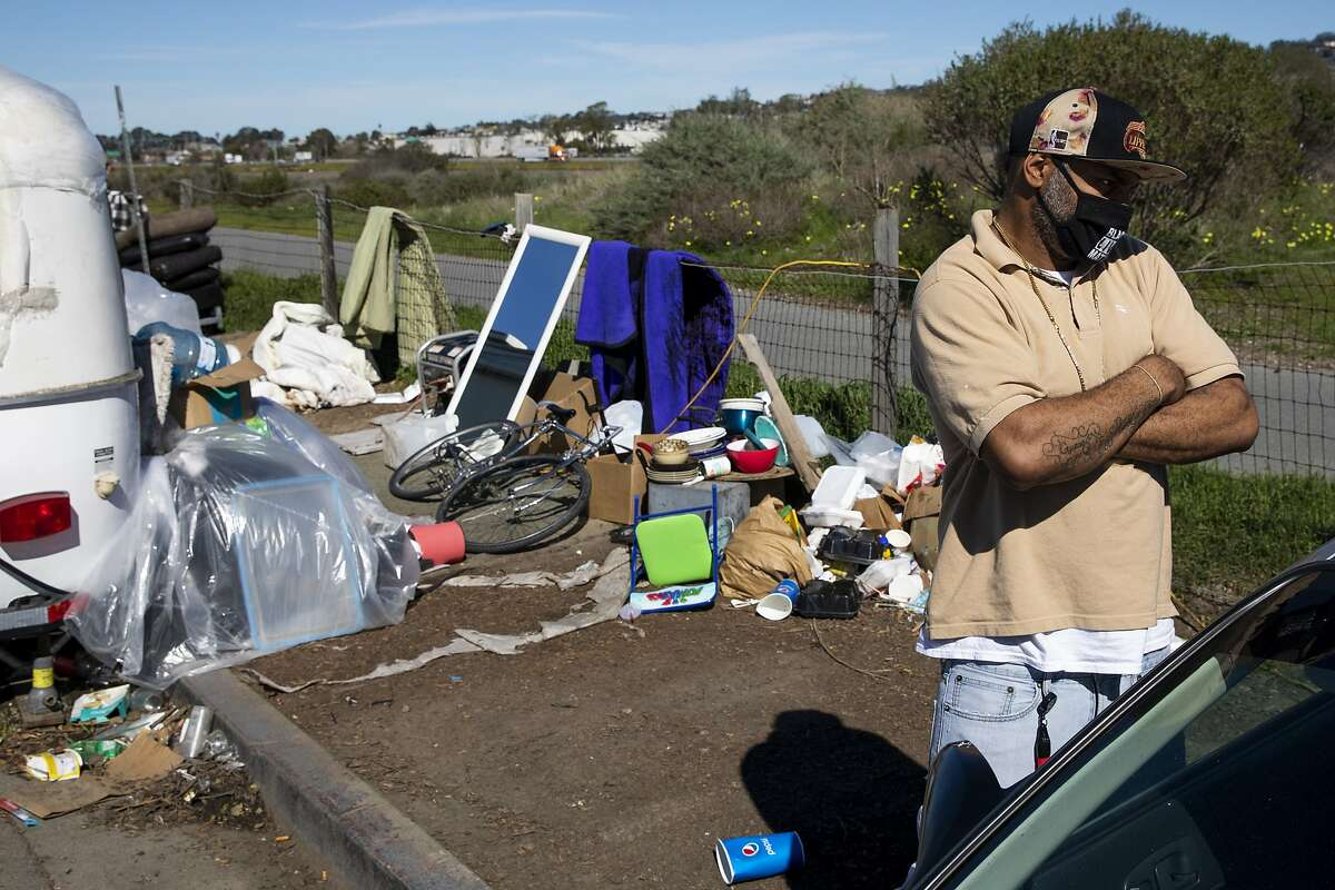 """Cmichael Viewins, 40, organizes items at the Rydin Road camp. He says the city's proposal would be an """"opportunity to have somewhere to live."""""""
