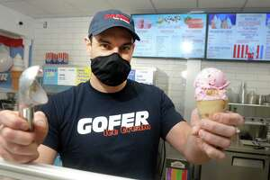 Co-owner Justin Ragusa holds an ice cream cone at Gofer Ice Cream, in Greenwich, Conn. Feb. 22, 2021. The ice cream shop just re-opened after a major fire in 2019. Golfer has announced it plans to open a new location soon in Stamford's Ridgeway Center.