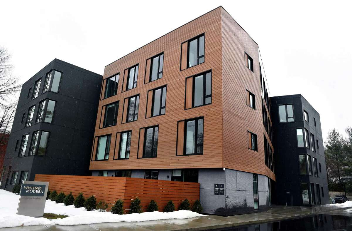The Whitney Modern apartment community in New Haven photographed on Feb. 22, 2021. The Modern New to the lot is a four-story building with 35 one- and two-bedroom apartments. Charlie Kaplan, a design principal at architectural firm GLUCK+, said the building was designed to be