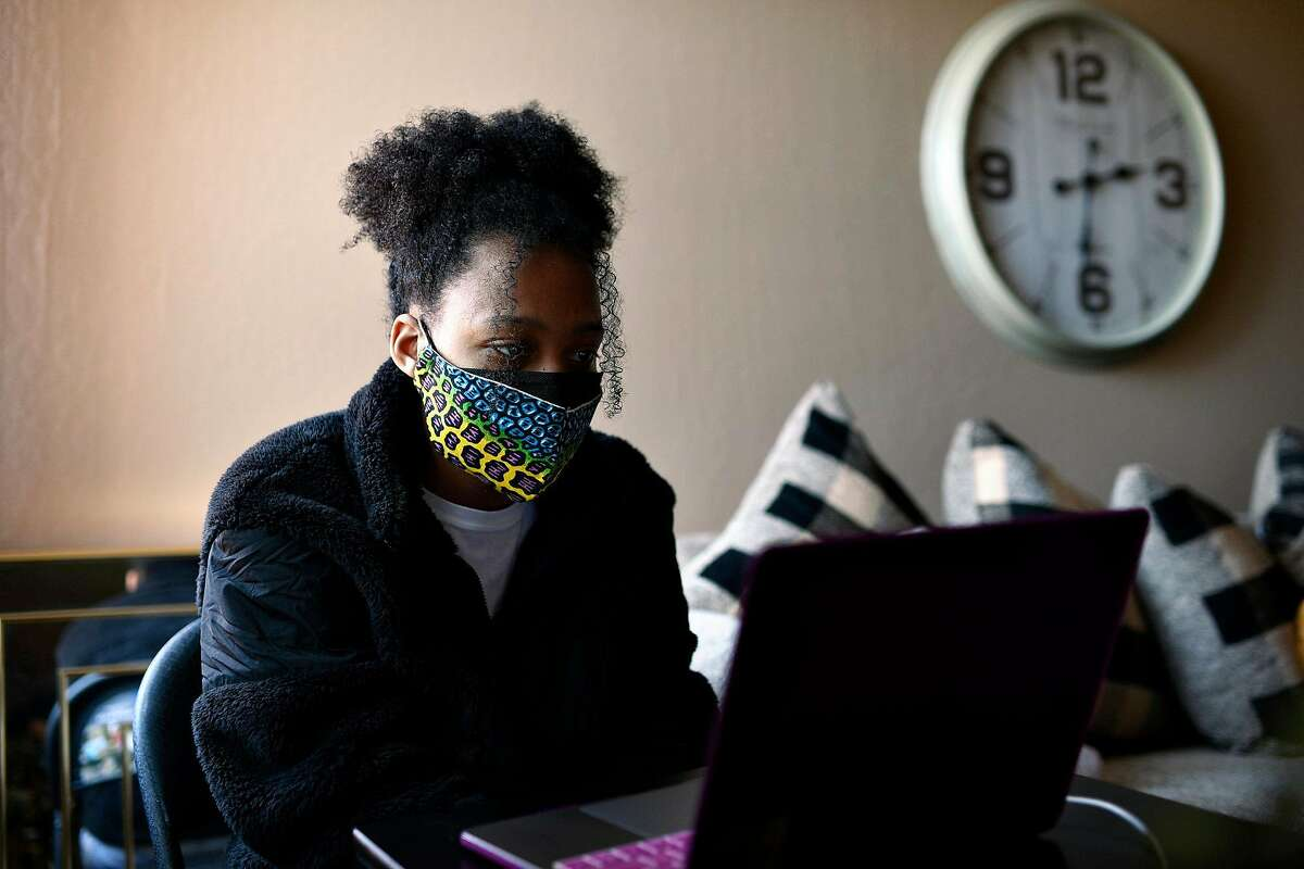 Kyra Abrams, a junior at UC Berkley, sits in on a remote class at Abrams' grandmother's home in San Pablo, Calif. on Monday, Feb 22, 2021. Abrams is a supporter of proposals that support racial equity in higher education.