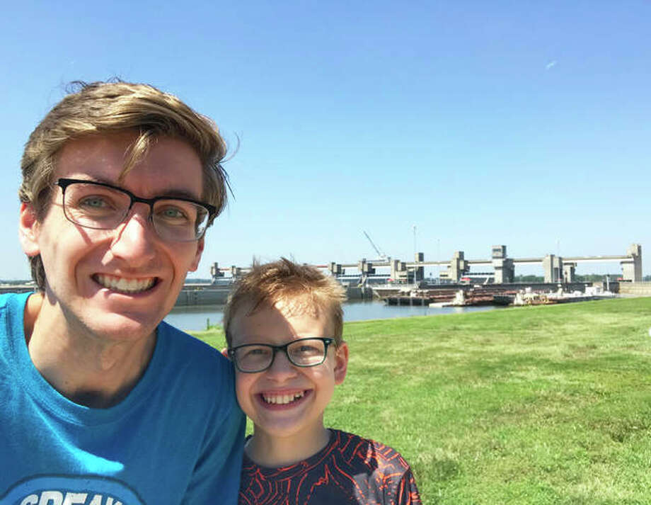 """Big Brother Austin and Little Brother Peyton stand before locks and dam in Madison County during an outing. All that's required by those approved to be """"Bigs"""" for """"Littles"""" is a commitment of four hours a month to a young person. Those hours can be split into different interactions or one outing or experience. All Big Brothers/Big Sisters are coordinated with a Little who lives within a 20 to 25 minute commute of each other. Photo: Courtesy Of Big Brothers Big Sisters Of Southwest Illinois For The Telegraph"""