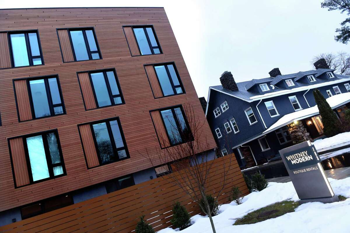 The Modern Residences (left) and the Cottage Residences (right) in the historic Abner Hendee home are part of the Whitney Modern apartment community in New Haven photographed on February 22, 2021.