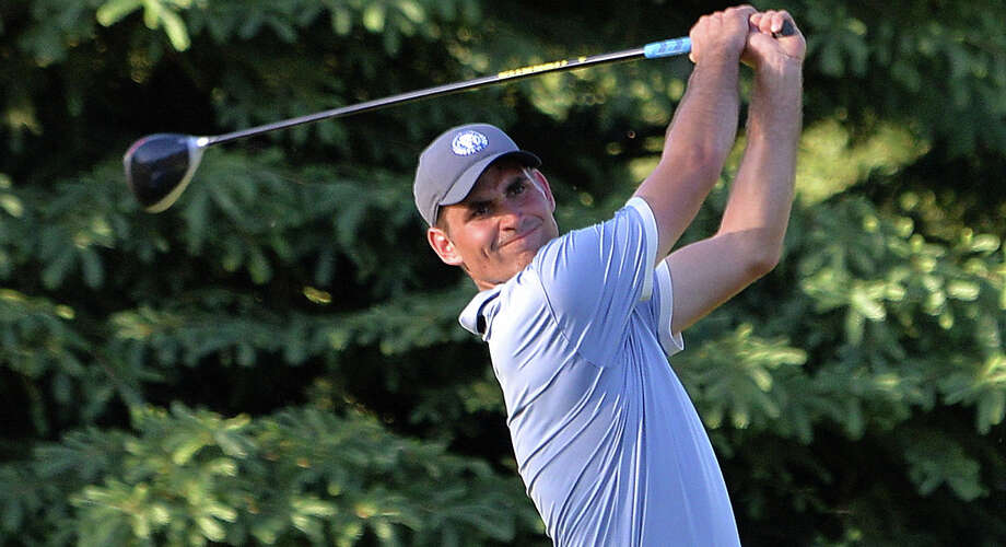 Midland's Austin Deiters tees off during his 108-hole marathon golf fundraiser on June 8, 2020 at the Midland Country Club. Deiters raised over $9,000 for flood relief to benefit Northwood University. Photo: Photo Provided / Robert Spears