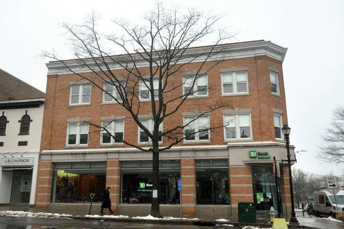 The tree standing at 235 Greenwich Ave. has been marked for removal, seen here in Greenwich, Conn. Feb. 22, 2021.