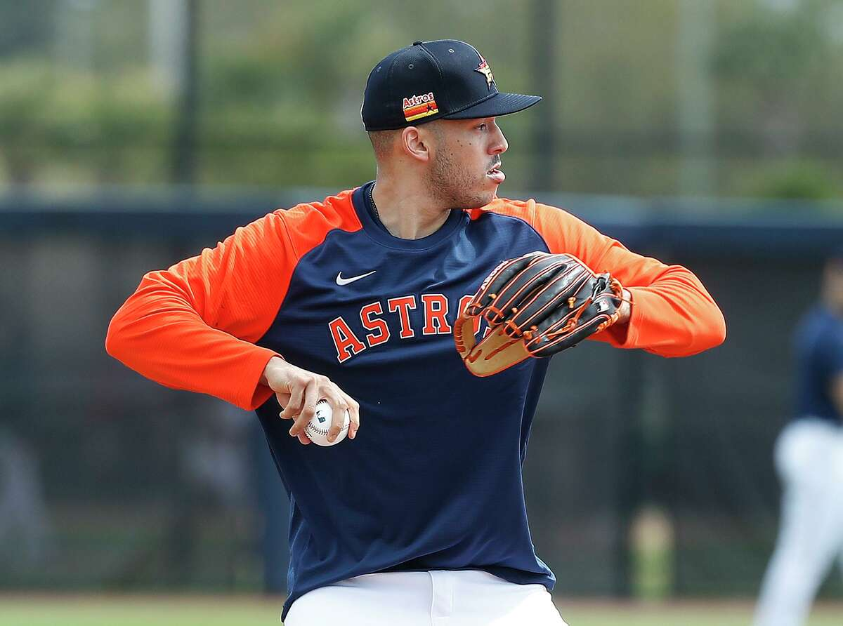 His neon orange sleeves distinguished Astros shortstop Carlos Correa from the rest of his teammates during Monday's first full-squad workout of spring training.