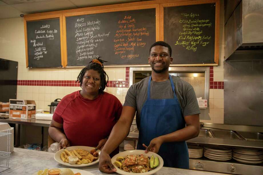 Angelia Govan, left, and son Isaac Brown pose for a portrait Monday, Feb. 22, 2021 at 4200 W. Illinois Ave. Suite 160. Other owners of Doris J's Kitchen not pictured include head chef Derek Brown, Brandon Govan, Royal Sanders and Marcus Miller.  Jacy Lewis/ Reporter-Telegram Photo: Jacy Lewis/ Reporter-Telegram