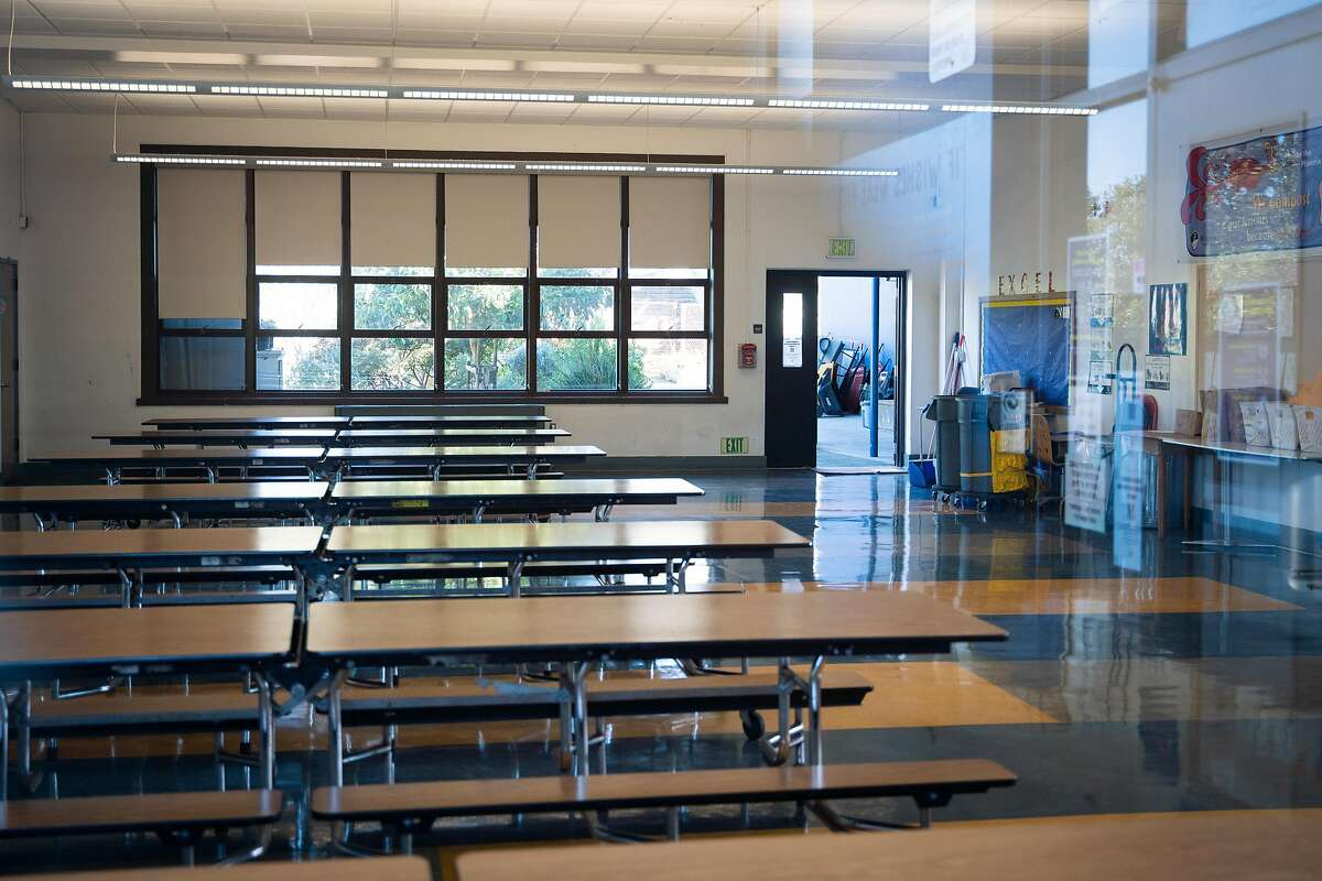 An empty cafeteria is seen at Sunset Elementary School in San Francisco, Calif., on Wednesday, Feb. 17, 2021.