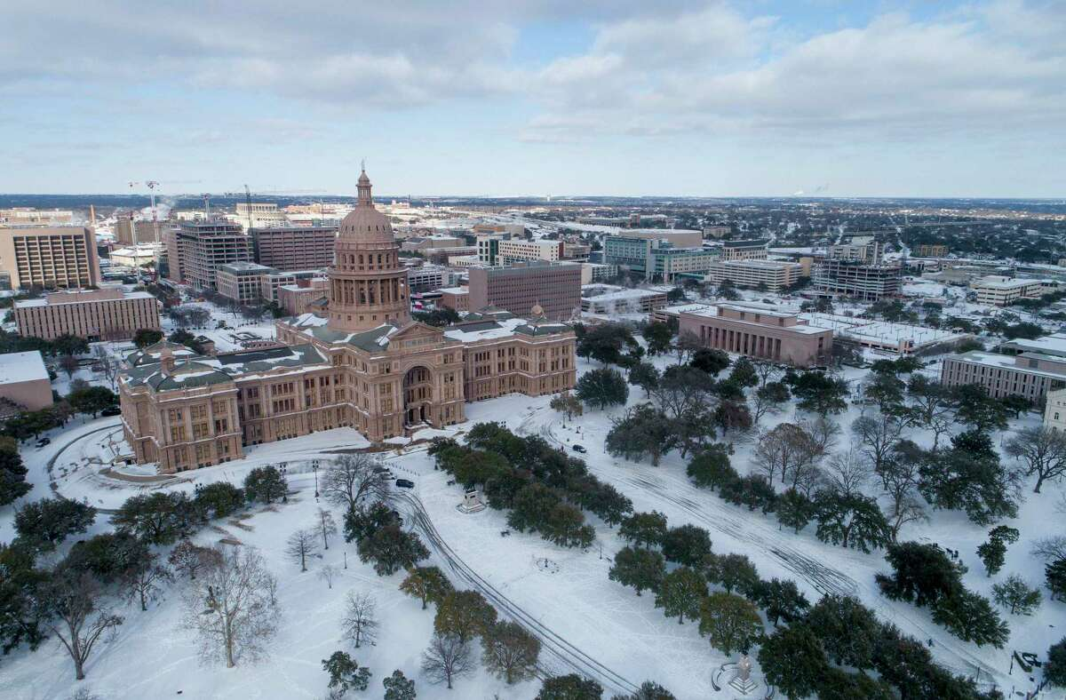 The Texas Capitol grounds are covered in snow on Monday, February 15, 2021. (Jay Janner/Austin American-Statesman/TNS)