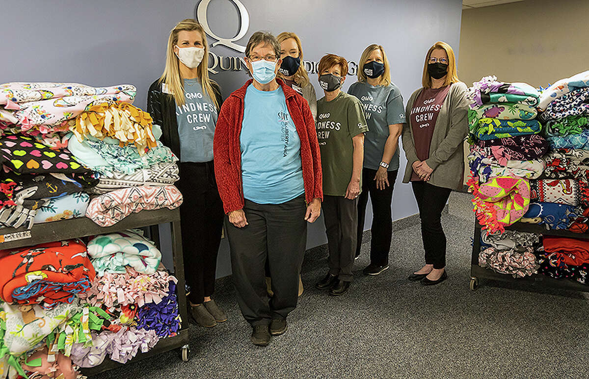 Quincy Medical Group community relations specialist Morgan Parker (from left), Melba Funk of Sleep in Heavenly Peace, Quincy Medical Group community support specialist Kayla Baumann and Quincy Medical Group employees and members of the Quincy Medical Group Kindness crew - Brenda Herndon, Pam Dietrich and Ann Reed - display some of the tied blankets the medical group's Kindness Crew made and donated.