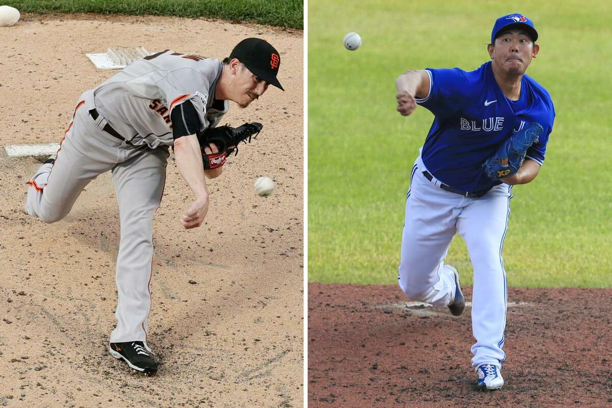 Giants pitcher Shun Yamaguchi, shown on right with Toronto last season, says he has studied former Giants pitcher Tim Lincecum.