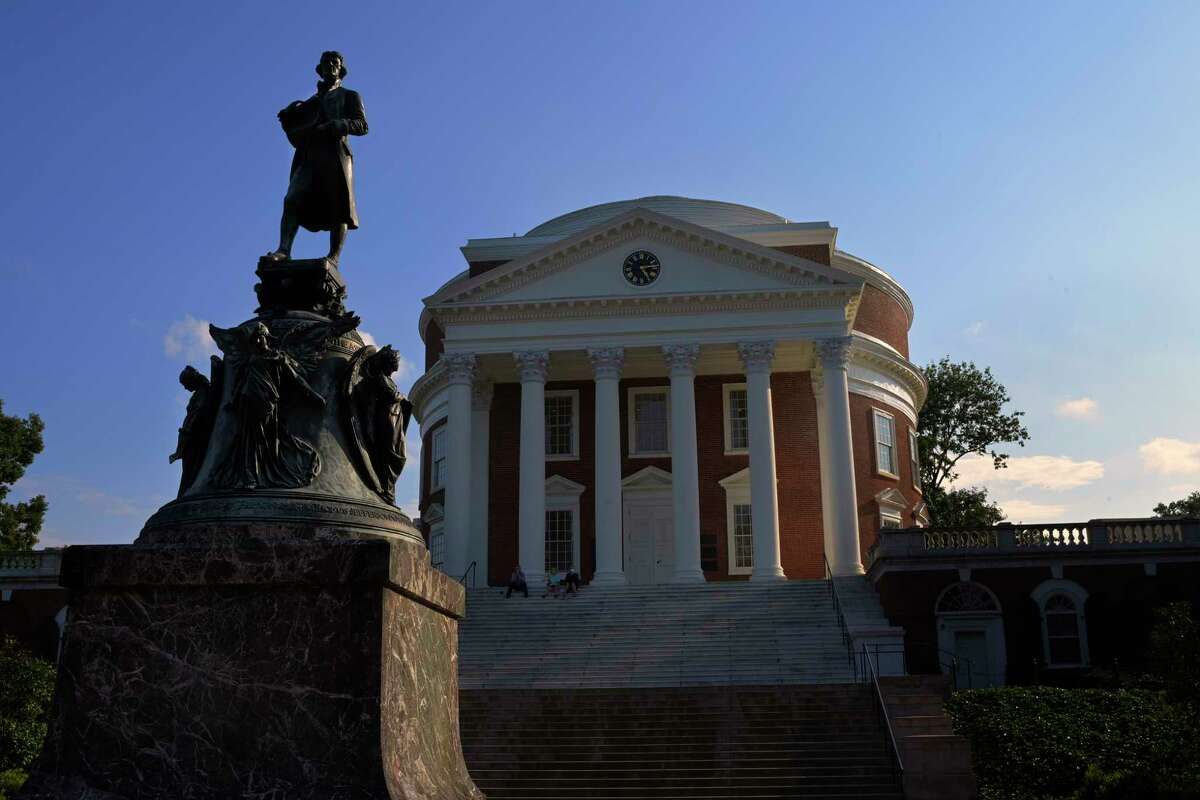 A statue of Thomas Jefferson stands in front of the Rotunda at the University of Virginia in Charlottesville.