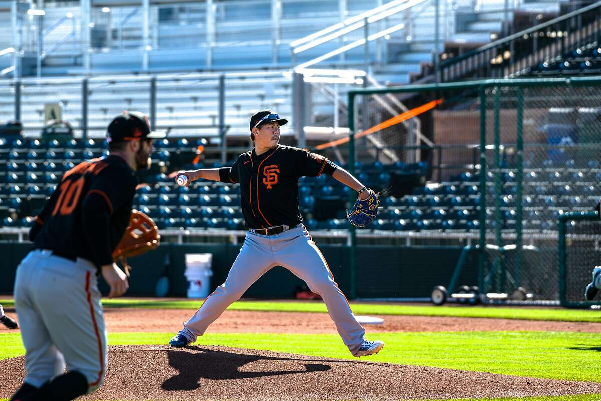 Shun Yamaguchi works through some bunt options during a practice at Scottsdale Stadium in Arizona. Yamaguchi was a star in 2019 for the Yomiuri Giants, as he went 16-4 with a 2.78 ERA.