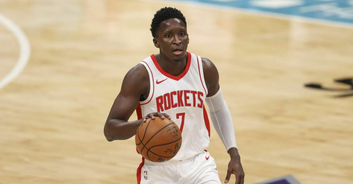 Houston Rockets guard Victor Oladipo (7) brings the ball up court against the Charlotte Hornets in the first half of an NBA basketball game in Charlotte, N.C., Monday, Feb. 8, 2021. (AP Photo/Nell Redmond)