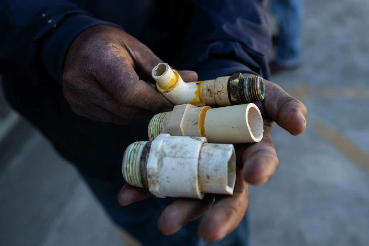 Levase Campbell of Missouri City holds plumbing parts he hopes to find for his home at Ferguson Plumbing at W. 26th Street on Feb. 22, 2021, in Houston. He waited in line for over an hour.