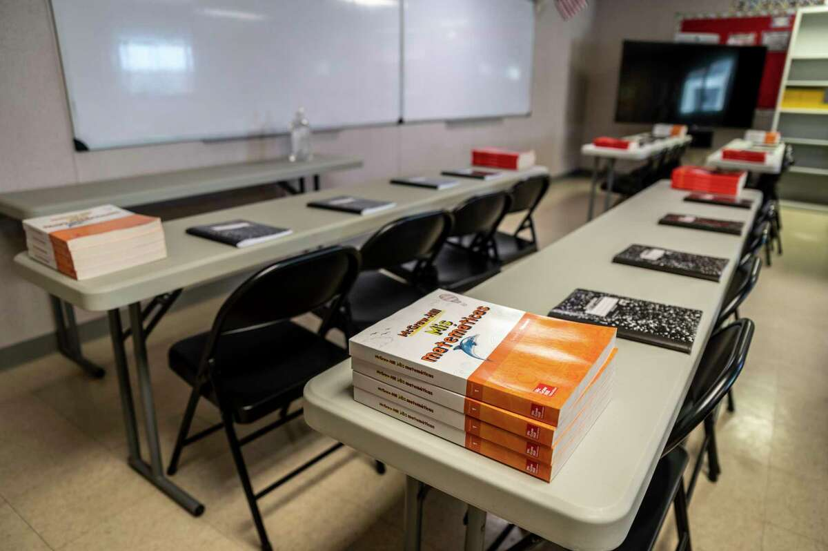 Textbooks and notebooks line tables inside a classroom at the facility.