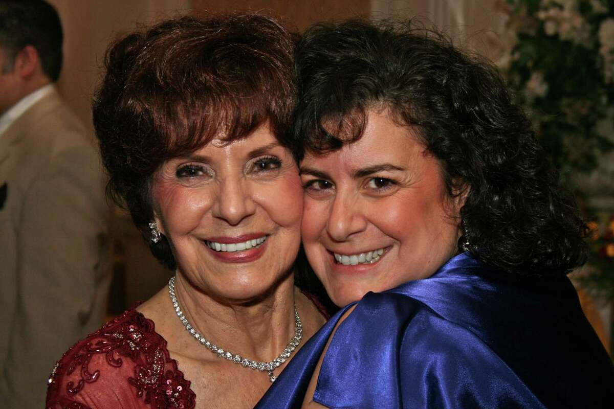 Rosanne Corcoran, right, and her mother, Rose, at Rose's 80th birthday party in 2008. Rose now has advanced dementia and lives with Corcoran and her family. Corcoran hopes to get the vaccine but has been unable to yet.