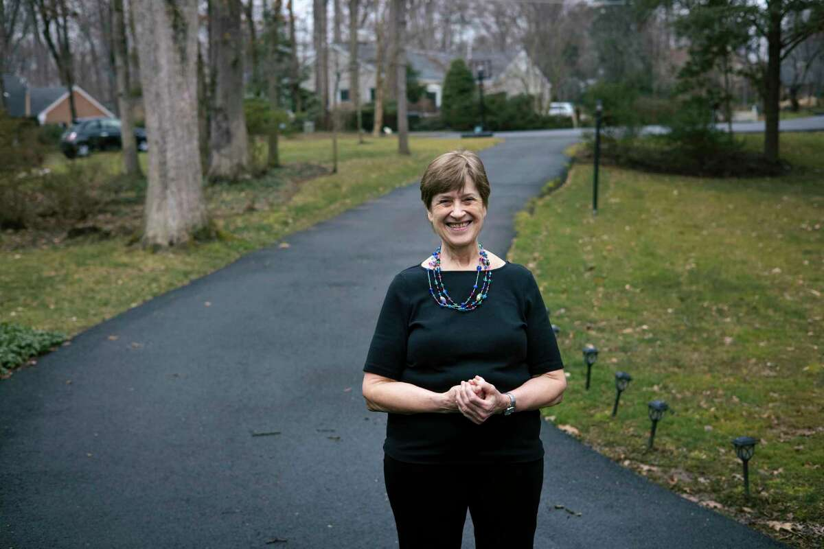 Alice Southworth, 75, outside her home in McLean, Va., Feb. 15, 2021, has received her first dose of the COVID-19 vaccine and is now planning a trip to Hilton Head Health, a wellness resort in South Carolina. A semiretired psychologist, she has continued to see a handful of patients throughout the coronavirus pandemic, but hasn?•t ventured beyond her hometown in more than a year. (Alyssa Schukar/The New York Times)