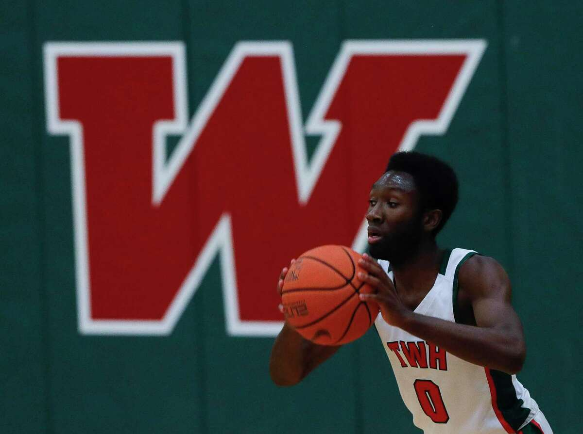 FILE - The Woodlands guard David Omokwale (0) looks to pass during the third quarter of a District 13-6A high school basketball game at The Woodlands High School, Tuesday, Feb. 2, 2020, in The Woodlands.
