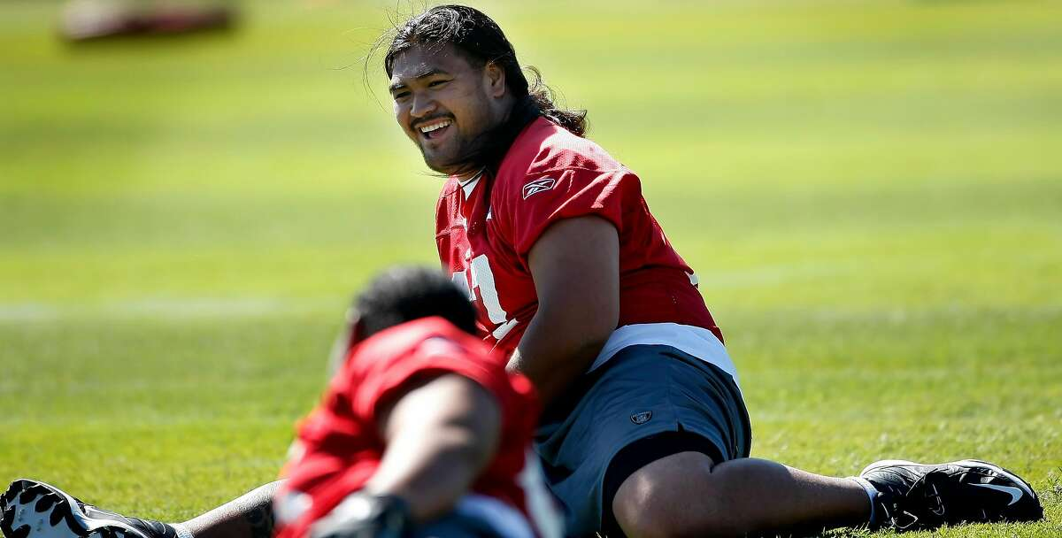 Mike Iupati, then a rookie offensive lineman with the 49ers, warms up at minicamp in Santa Clara on April 30, 2010.