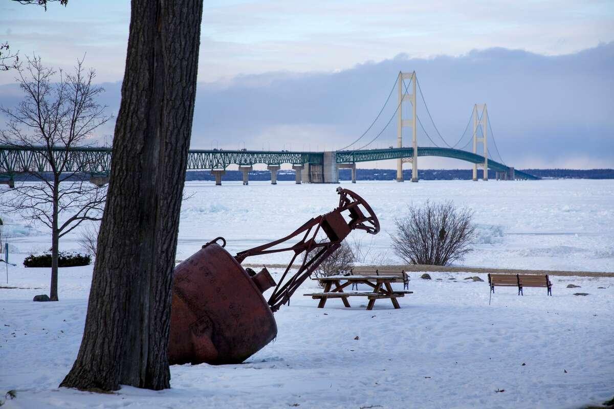 Blue ice piles up on Lake Huron near the Mackinac Bridge Friday, Feb. 19, 2021 in Mackinaw City. (Doug Julian/for the Daily News)