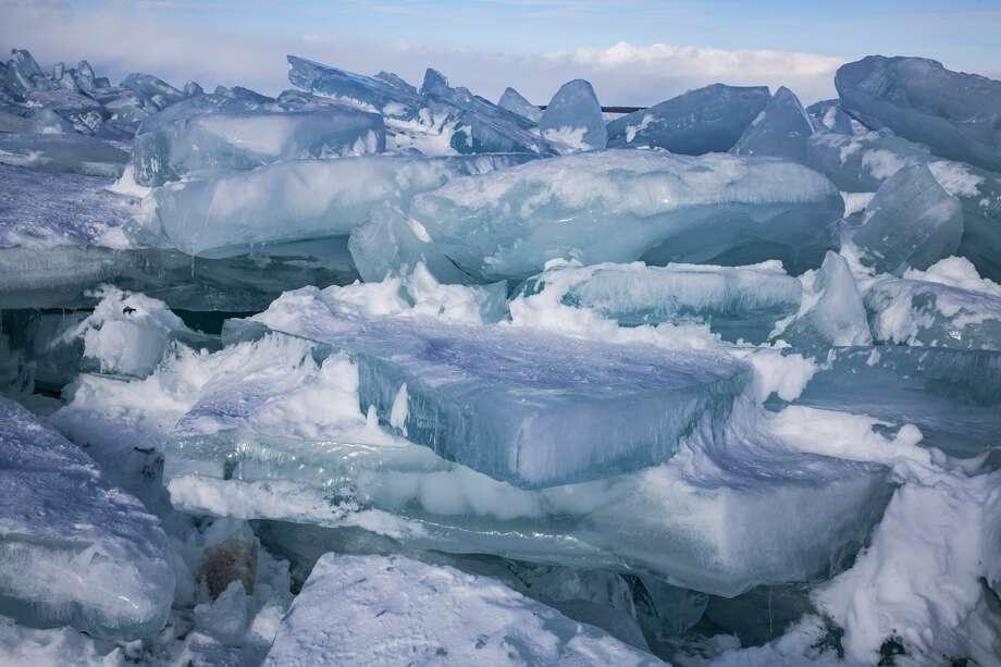 Blue ice piles up on Lake Huron near the Mackinac Bridge Friday, Feb. 19, 2021 in Mackinaw City. (Doug Julian/for the Daily News) Photo: (Doug Julian/for The Daily News)
