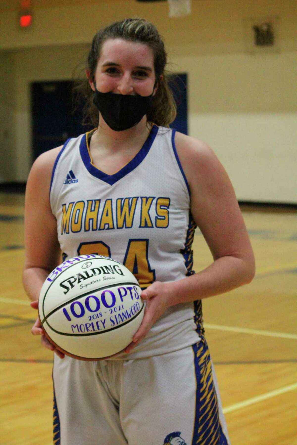 Morley Stanwood's Brooke Brauher was presented with a ball for hitting the 1,000-point total on Monday. (Pioneer photo/John Raffel)