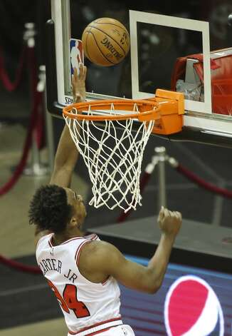 Chicago Bulls center Wendell Carter Jr. (34) scores a basket during the first quarter of a NBA game against the Houston Rockets Monday, Feb. 22, 2021, at Toyota Center in Houston. Photo: Yi-Chin Lee/Staff Photographer / © 2021 Houston Chronicle