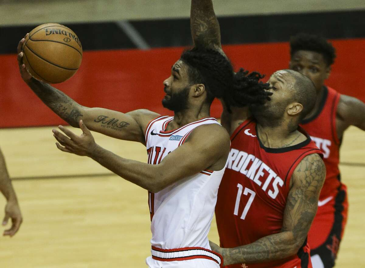 Chicago Bulls guard Coby White (0) goes for the basket while Houston Rockets forward P.J. Tucker (17) is trying to stop him during the thid quarter of a NBA game Monday, Feb. 22, 2021, at Toyota Center in Houston.