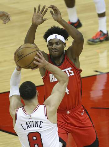 Houston Rockets forward Danuel House Jr. (4) defensing Chicago Bulls guard Zach LaVine (8) during the second quarter of a NBA game Monday, Feb. 22, 2021, at Toyota Center in Houston. Photo: Yi-Chin Lee/Staff Photographer / © 2021 Houston Chronicle