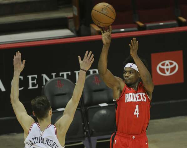 Houston Rockets forward Danuel House Jr. (4) scorea a three point basket during the first quarter of a NBA game against the Chicago Bulls Monday, Feb. 22, 2021, at Toyota Center in Houston. Photo: Yi-Chin Lee/Staff Photographer / © 2021 Houston Chronicle