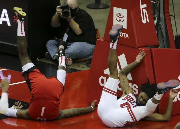 Houston Rockets guard John Wall (1) and Chicago Bulls guard Coby White (0) fll onto the floor as White fouls on Wall during the thid quarter of a NBA game Monday, Feb. 22, 2021, at Toyota Center in Houston. Photo: Yi-Chin Lee/Staff Photographer / © 2021 Houston Chronicle
