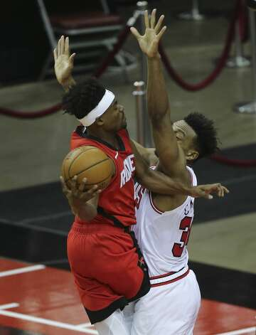 Houston Rockets forward Danuel House Jr. (4) is fouled by Chicago Bulls center Wendell Carter Jr. (34) during the thid quarter of a NBA game Monday, Feb. 22, 2021, at Toyota Center in Houston. Photo: Yi-Chin Lee/Staff Photographer / © 2021 Houston Chronicle