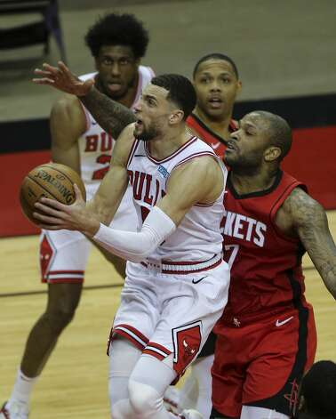 Chicago Bulls guard Zach LaVine (8) goes for the basket while Houston Rockets forward P.J. Tucker (17) is trying to stop him during the thid quarter of a NBA game Monday, Feb. 22, 2021, at Toyota Center in Houston. Photo: Yi-Chin Lee/Staff Photographer / © 2021 Houston Chronicle