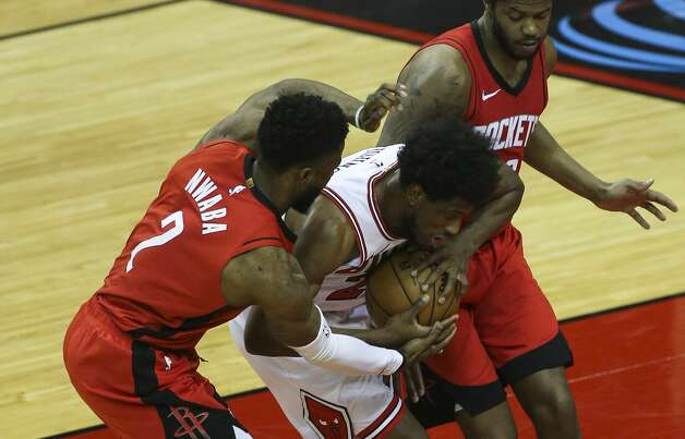Houston Rockets players David Nwaba (2) and Justin Patton (26) battle for the ball with Chicago Bulls forward Thaddeus Young (21) during the thid quarter of a NBA game Monday, Feb. 22, 2021, at Toyota Center in Houston. Photo: Yi-Chin Lee/Staff Photographer / © 2021 Houston Chronicle
