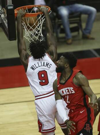 Chicago Bulls forward Patrick Williams (9) dunks the ball as Houston Rockets guard David Nwaba (2) watches on during the thid quarter of a NBA game Monday, Feb. 22, 2021, at Toyota Center in Houston. Photo: Yi-Chin Lee/Staff Photographer / © 2021 Houston Chronicle