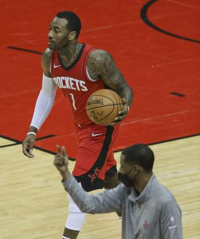 Houston Rockets guard John Wall (1) dribbles while head coach Stephen Silas is talking to players during the second quarter of a NBA game against the Chicago Bulls Monday, Feb. 22, 2021, at Toyota Center in Houston. Photo: Yi-Chin Lee/Staff Photographer / © 2021 Houston Chronicle